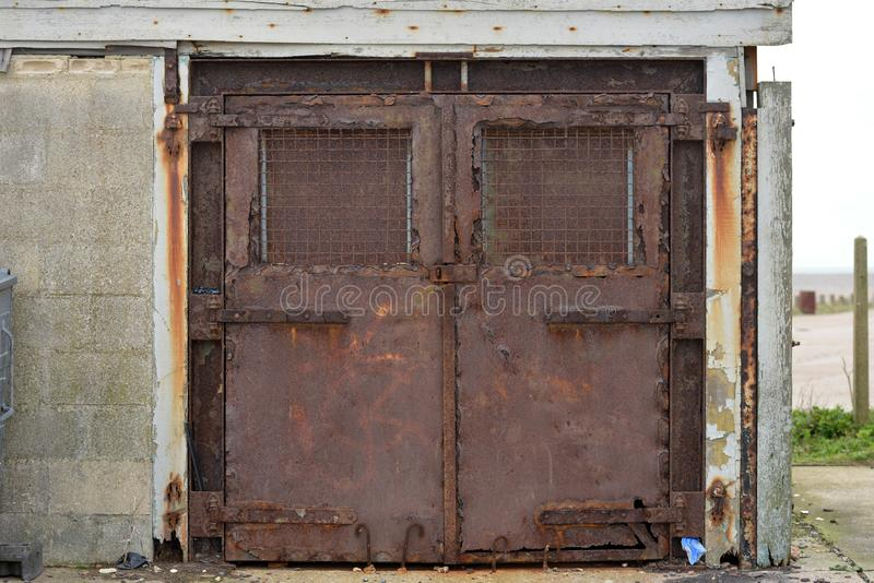 Rusty doors. Rusty metal doors locked shut, Newhaven, UK royalty free stock images