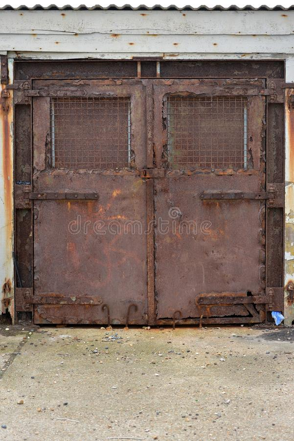 Rusty doors. Rusty metal doors locked shut, Newhaven, UK stock image