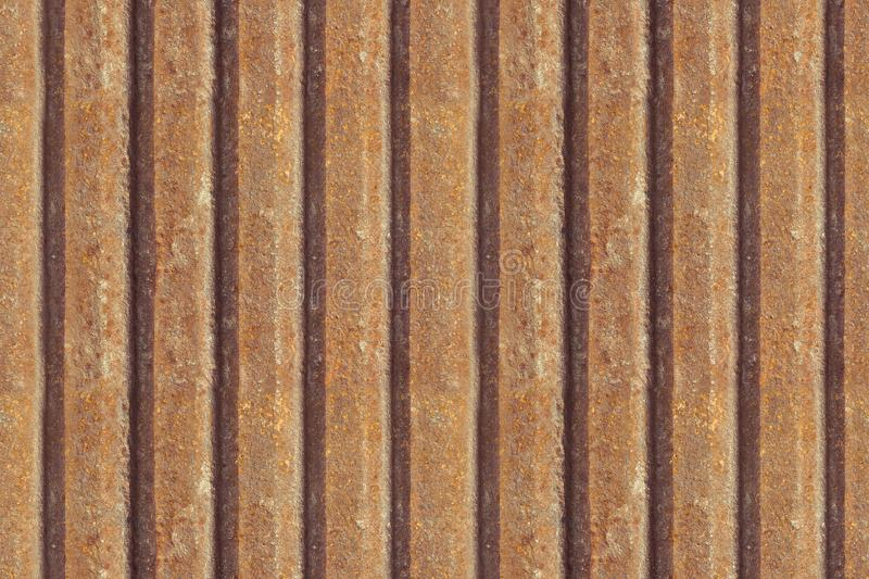 Rusty metal fence, seamless background. Rusty metal texture. Iron, zinc surface rust. Old industrial dirty metal seamless panel. royalty free stock image