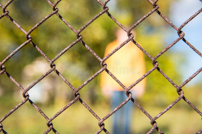 The Rusty metal grille fence macro and nature man background. Rusty metal grille fence macro and nature and man background stock image
