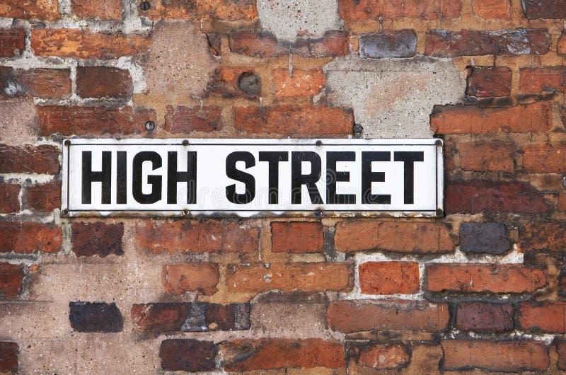 Rusty Metal High Street Road Sign On Brick Wall stock photos