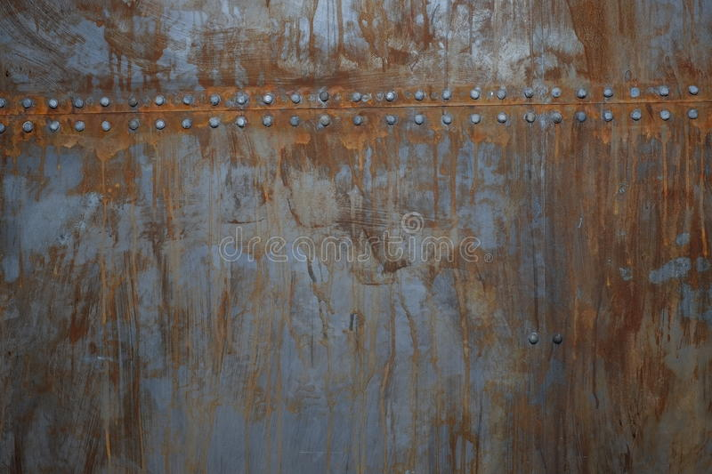Rusty metal with rivets royalty free stock photography