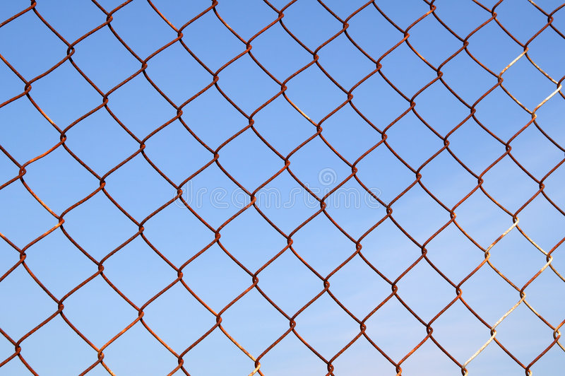 Rusty metal security fence stock photography