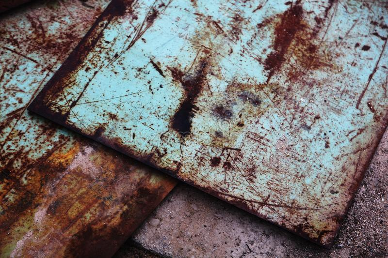 Rusty metal sheets. With scratches in brown overlapping each other stock photos