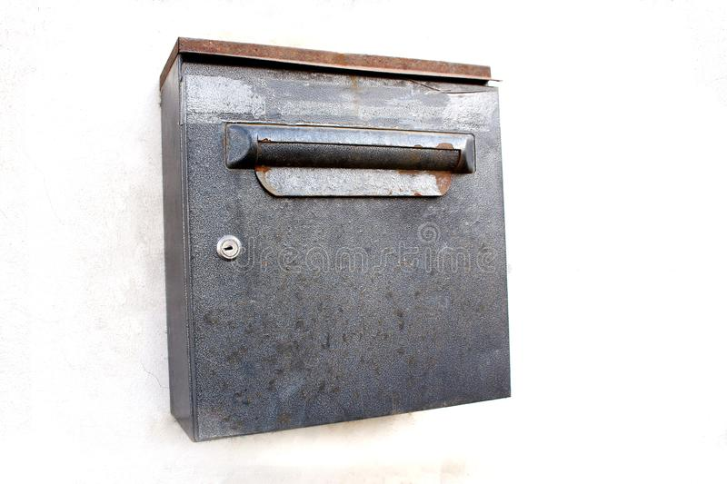 Rusty metal square mail box on white wall background stock photos