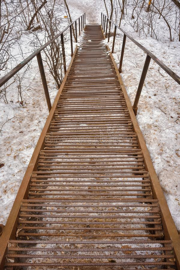 Rusty metal stairs going down royalty free stock photo