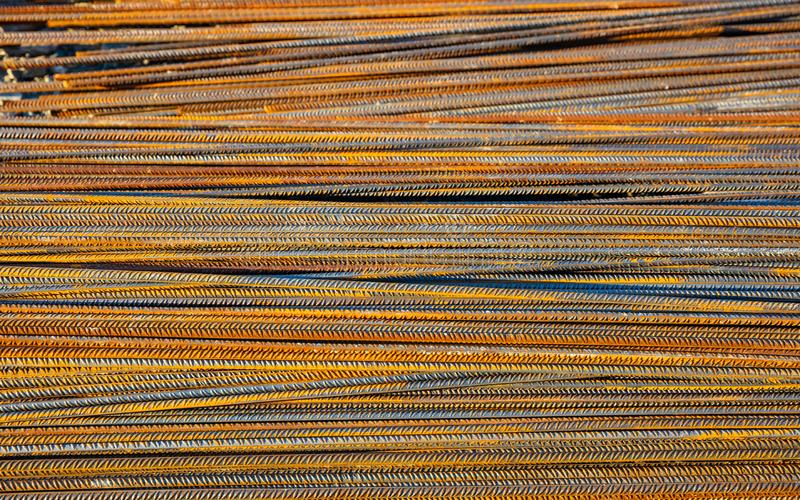 Rusty metal steel reinforcement bars, rods at a construction site royalty free stock photo