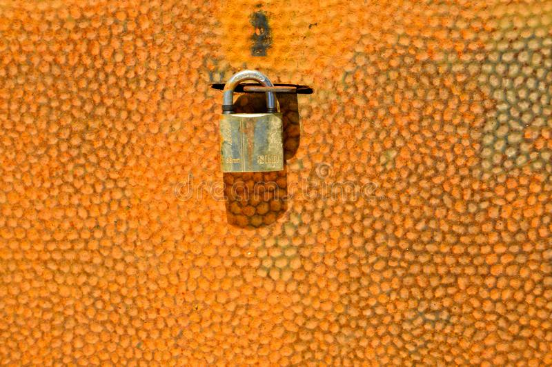 Rusty metal texture and padlock stock photo