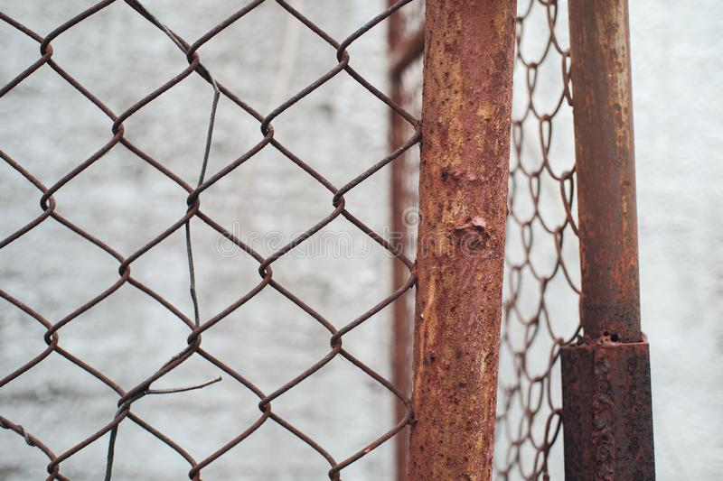 Rusty metal wire fence. Background stock photography