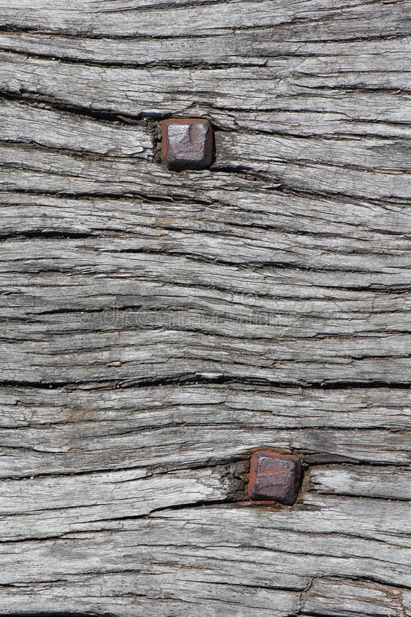 Rusty nails in wood texture stock photo