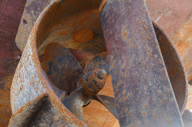 Rusty in the nozzle and the rudder of the ship, which stands in the dry dock royalty free stock photo