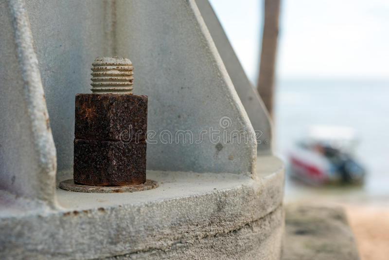 Rusty nut near sea effect from salt stock photography