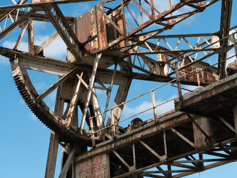 Rusty old abandoned lifting winch in a disused dock royalty free stock image