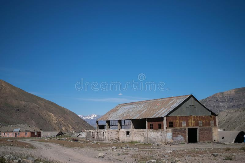 Rusty old abandoned meat factory in a large desert area stock photos