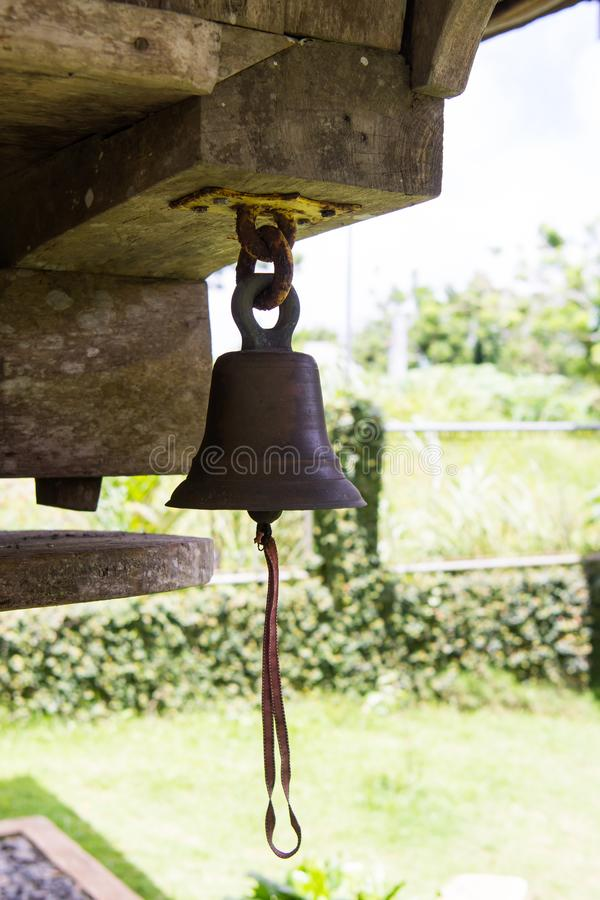 Old bell for alarming. Rusty old bell for alarming to alert or to attention others royalty free stock photo