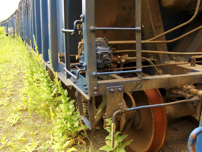 Rusty old railroad boxcar. An old rusty railroad boxcar sitting abandoned in an old New England rail yard royalty free stock photography