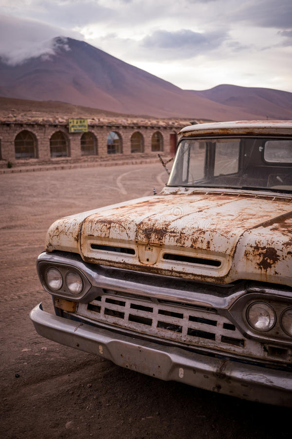 Rusty, old, broken pickup truck. A pickup truck (ute) stands parked in a wild west desert town never to be driven again stock photo