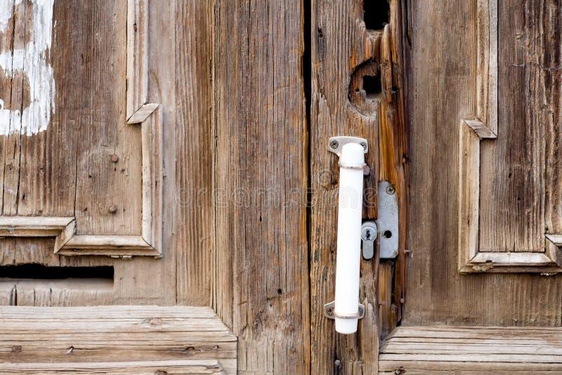 Rusty old cabin door handle in dusky light closeup. Image royalty free stock photos