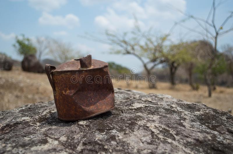 Rusty old can on a rock in a desert stock photos