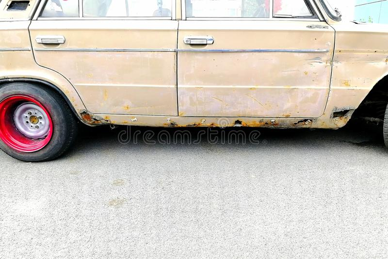 Rusty old car with rear wide wheels in the style of drift. royalty free stock photo