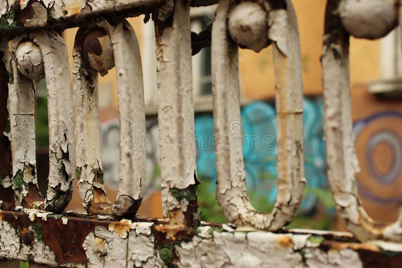 Rusty Old Fence Fragment Foreground And Graffiti Wall Background City Sofia Bulgaria. Rusty Old Fence Fragment Foreground And Graffiti Wall Background Sofia stock photo