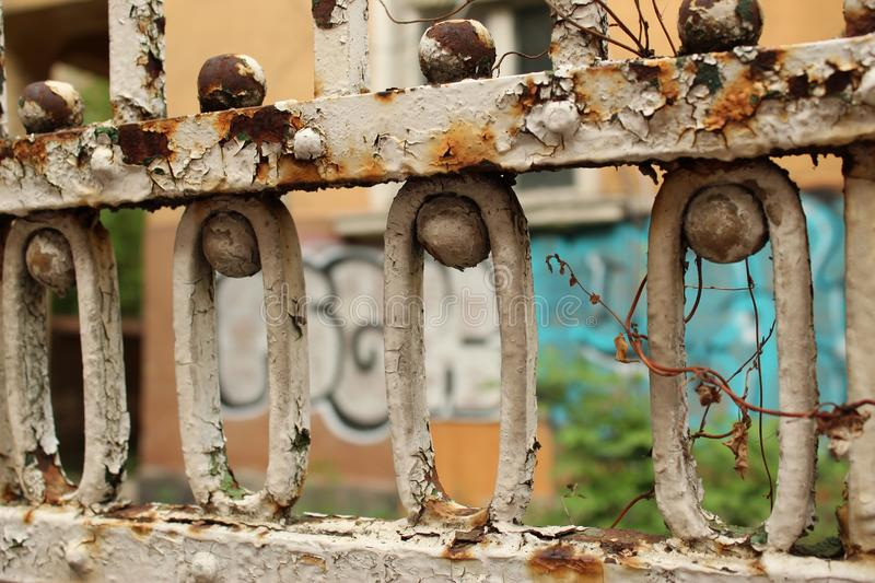 Rusty Old Fence Fragment Foreground And Graffiti Wall Background City Sofia Bulgaria. Rusty Old Fence Fragment Foreground And Graffiti Wall Background Sofia stock image