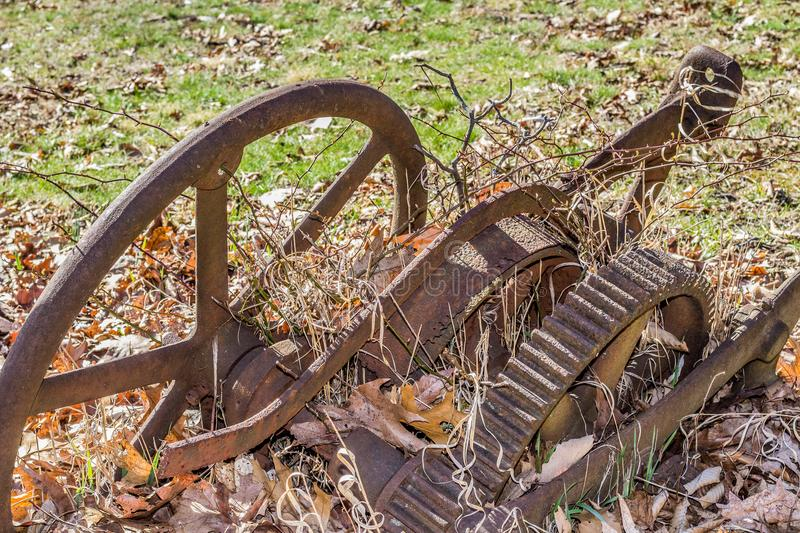 Old rusty gears from antique farm machinery stock photos