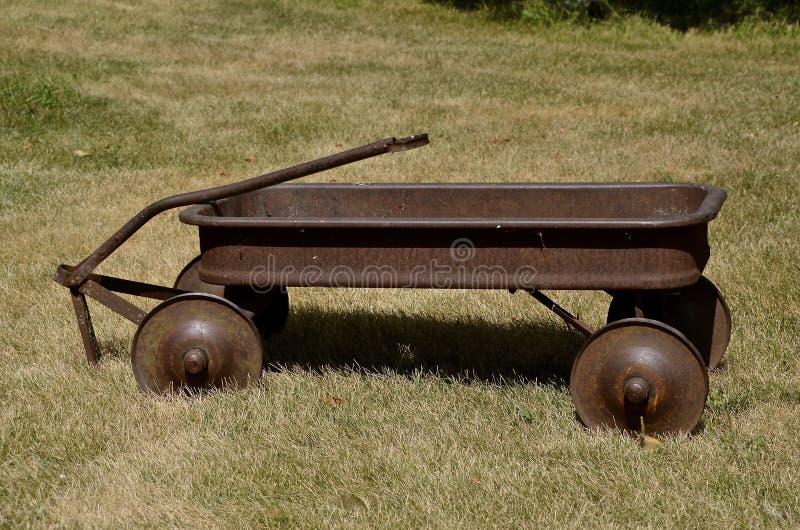Rusty old kids wagon royalty free stock photos