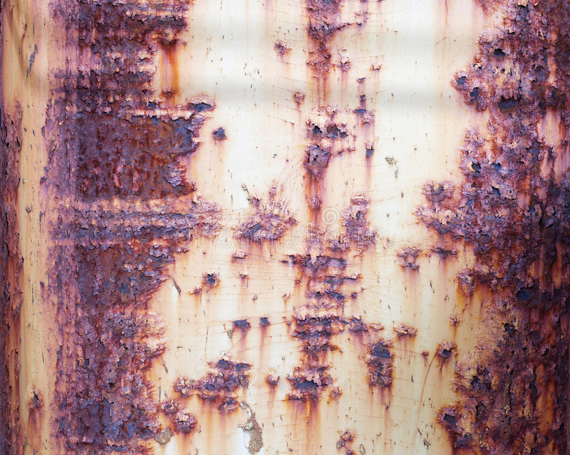Rusty old metal surface. The rough red rusty old metal wall royalty free stock image