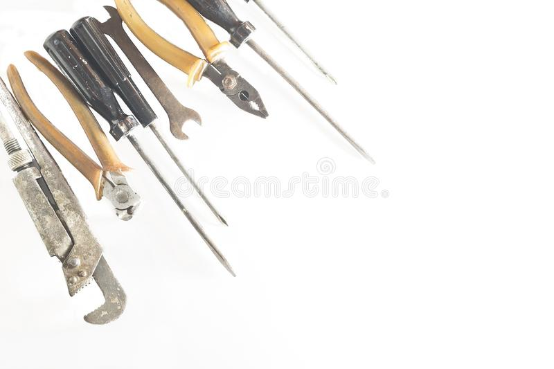Rusty old metal tools located in the corner royalty free stock photo