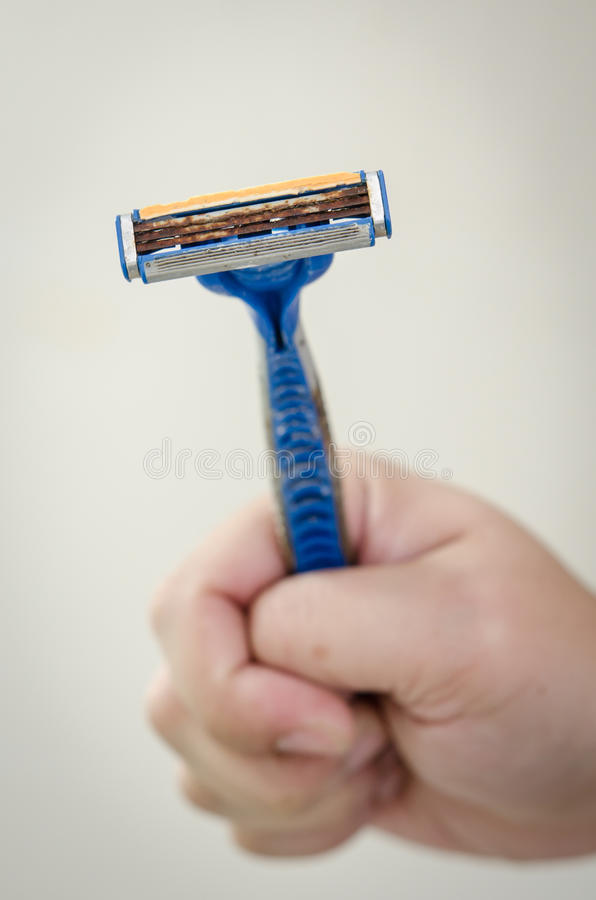 Rusty old razor. A shaving razor become rusty stock images
