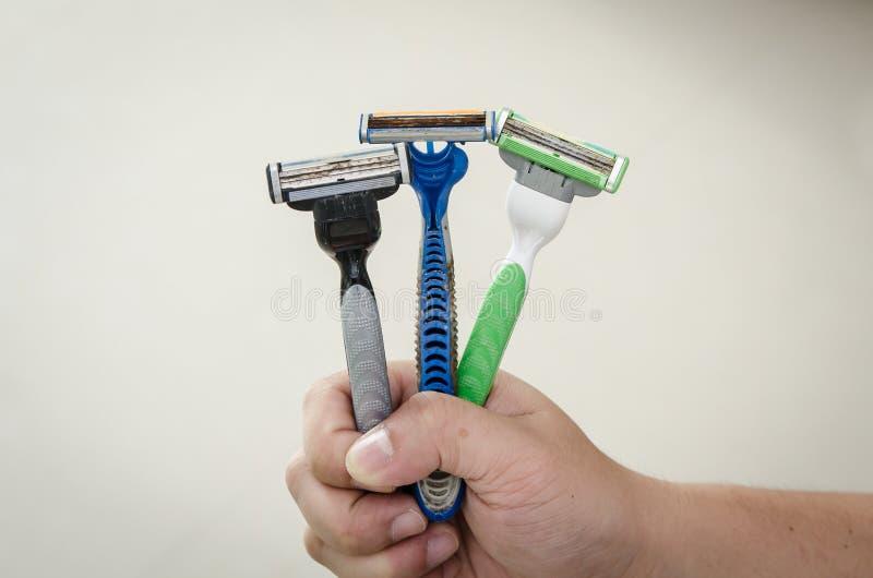 Rusty old razor. Three shaving razor become rusty royalty free stock photography