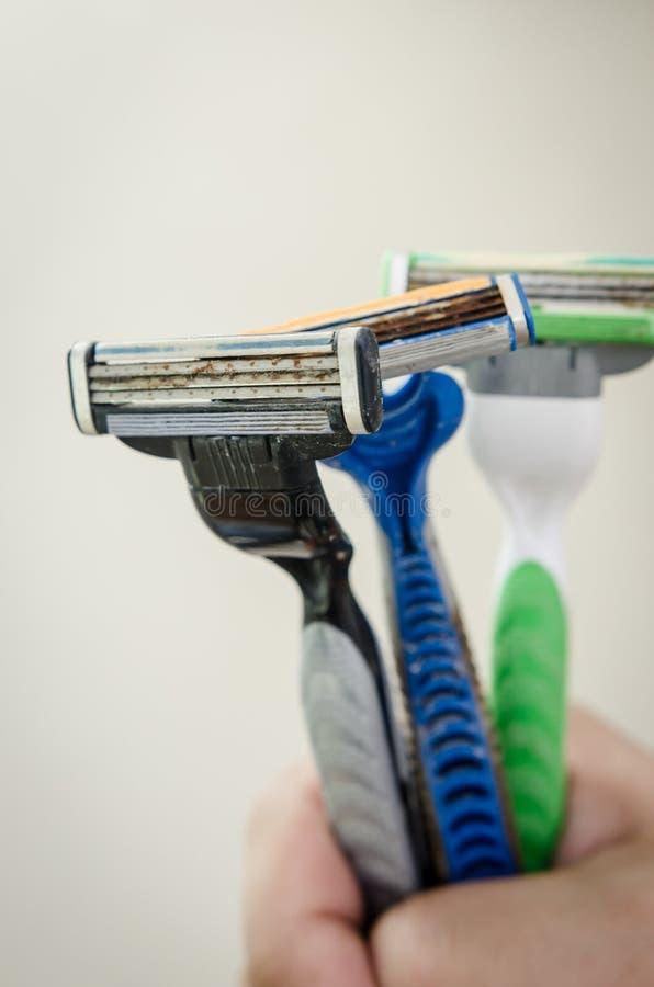 Rusty old razor. Three shaving razor become rusty royalty free stock image