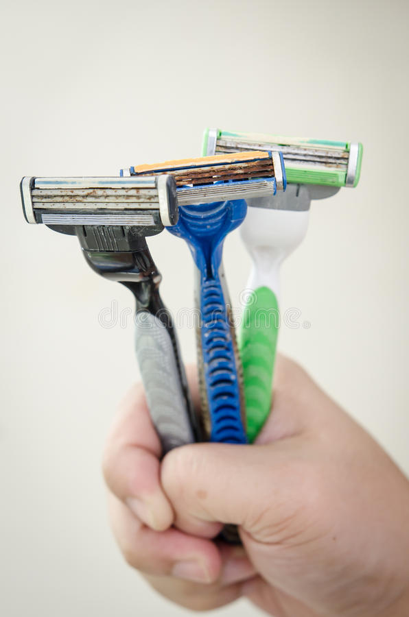 Rusty old razor. Three shaving razor become rusty royalty free stock photo