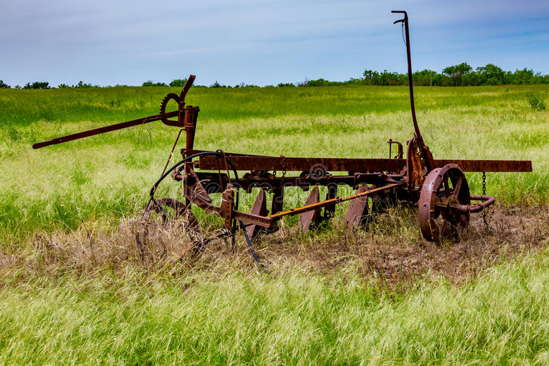 Rusty Old Texas Metal Farm Equipment in Field. Very Old and Rusty Vintage Texas Farm Equipment Rusting in a Texas Field royalty free stock photos