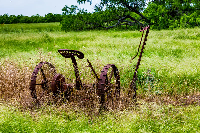 Rusty Old Texas Metal Farm Equipment in Field. Very Old and Rusty Vintage Texas Farm Equipment Rusting in a Texas Field royalty free stock image