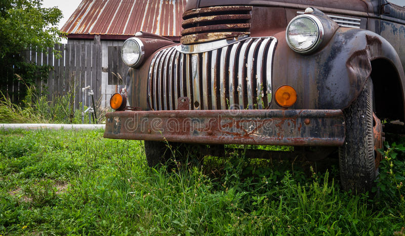 Rusty old truck in farm field royalty free stock photography