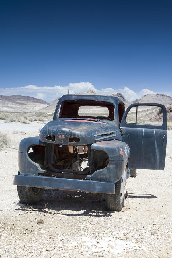 Rusty Old Truck in Ghost City Rhyolite in in Goldwell Open Air M. Useum in Nevada, United States. Vertical Image Composition royalty free stock photo