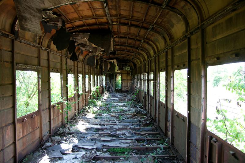Rusty overgrown abandoned and destroyed train wagon. Echo of the Georgian-Abkhaz war stock image