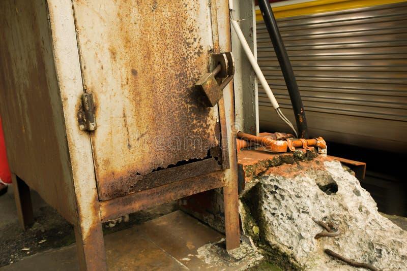 Rusty pad lock seal a metal box in indonesia stock image