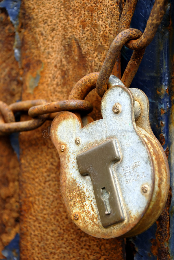 Rusty Padlock and Chain. Old padlock and rusty chain, with shallow depth of field stock images