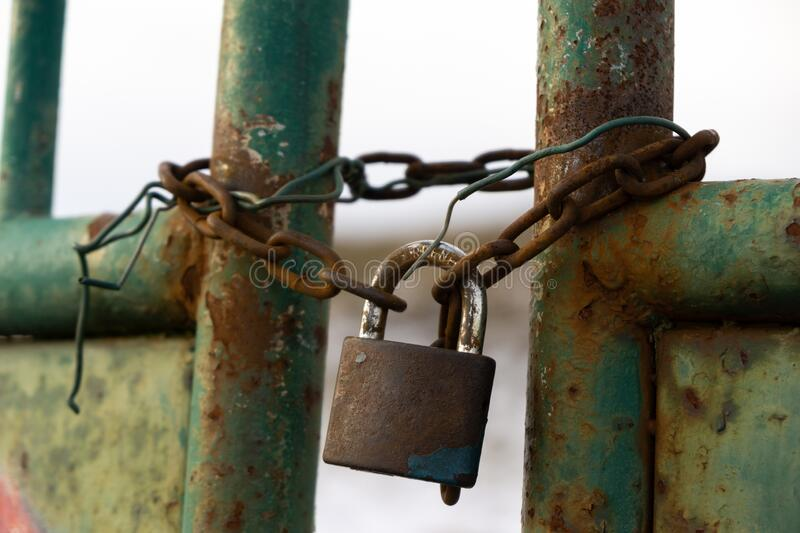 Rusty Padlock on the gate in the meadow fence. Slovakia stock photo