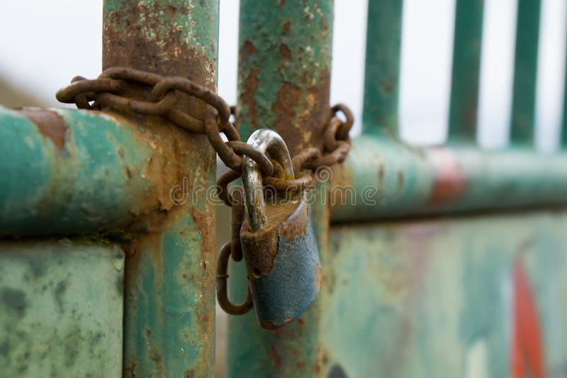 Padlock on the gate in the meadow fence. Slovakia stock images