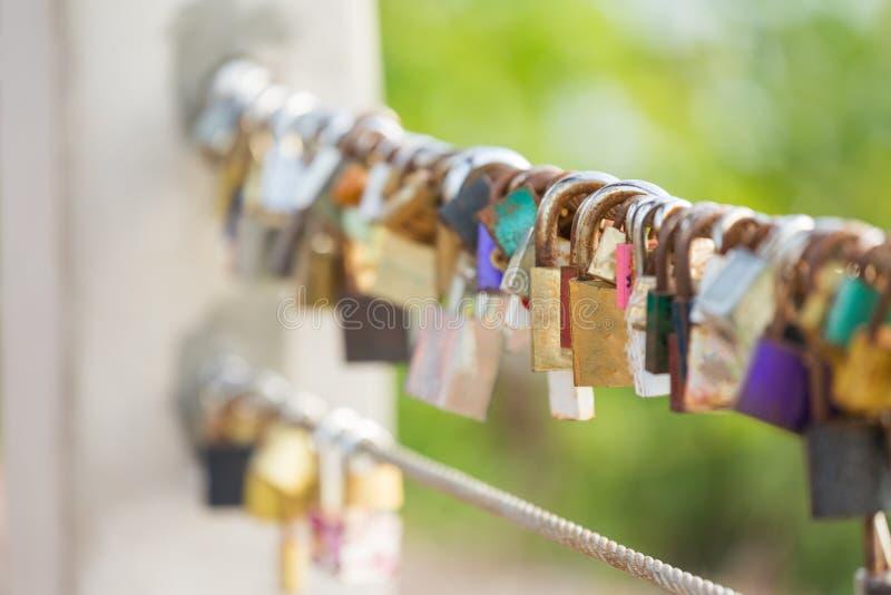 Rusty padlocks locking on steel rod. Rusty padlocks locking together on steel rod stock photos