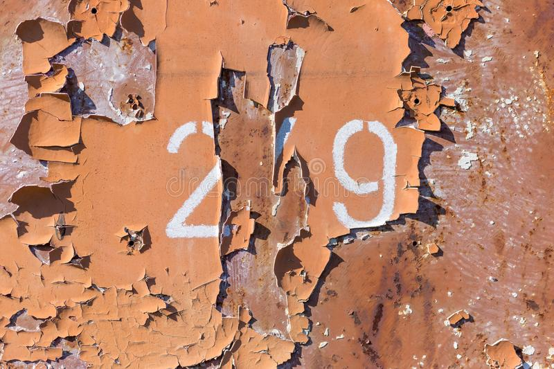 Rusty paint steel background with numbers royalty free stock image