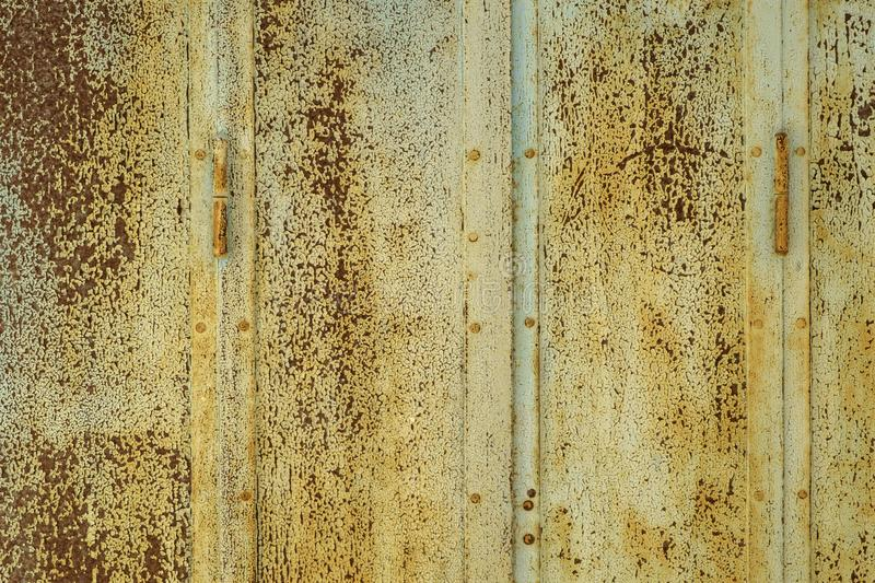 Rusty painted metal shutters full frame background. Texture stock photos