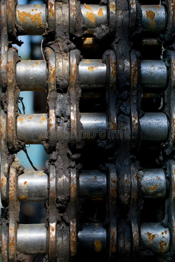 Rusty piece of engine chain from an old machine royalty free stock photo