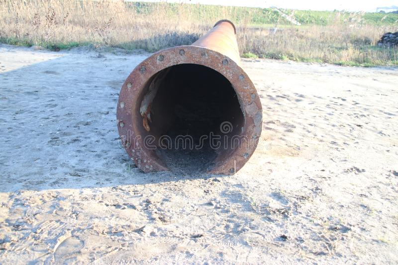 Rusty pipe at construction site which will be used for sand transportation in Pijnacker in the Netherlands. Rusty pipe at construction site which will be used stock photos