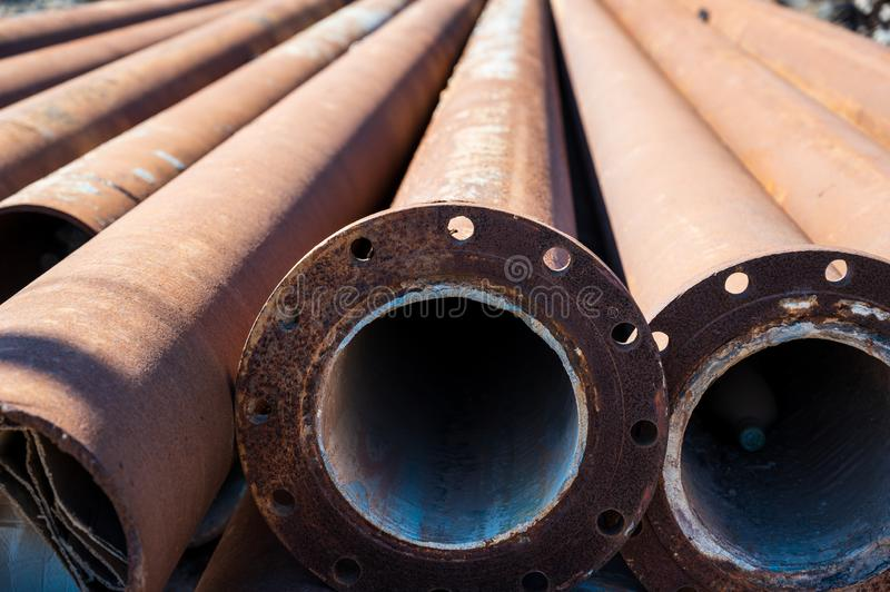 Rusty pipes lie on the ground royalty free stock photography