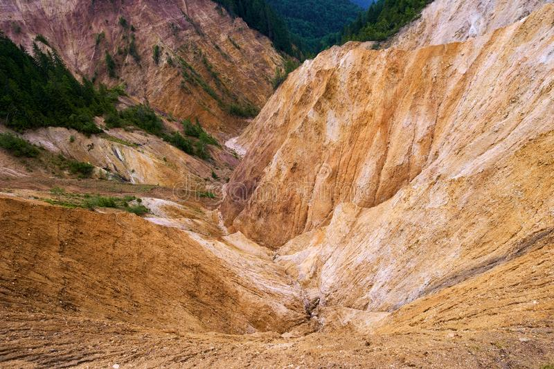 The Rusty Pit in Apuseni, Romania. Erosional view of Ruginoasa Pit from Apuseni mountains, Romania stock image
